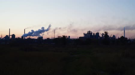 ozón : Smoke from the chimneys of a metallurgical plant against the sky at dawn