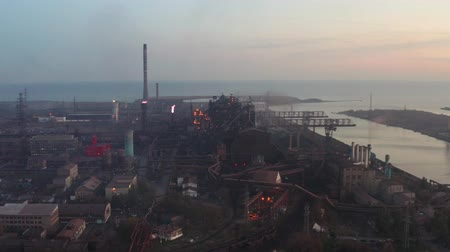 blast furnace : Blast furnaces by the sea in the evening. Environmental problems. Aerial view Stock Footage