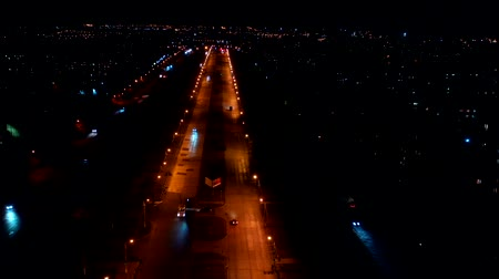 Aerial view of the city streets. Timelapse of the night city.