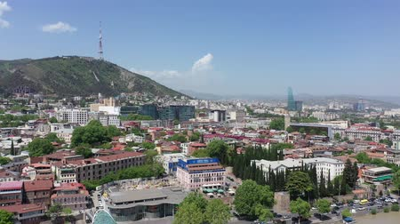 Tbilisi, Georgia - May 8, 2019: View of the city of Tbilisi, the capital of Georgia. Aerial view Stock Footage