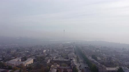 Cloud of fog and smog pollution covers the city. aerial view.