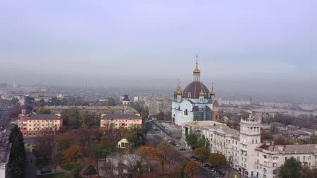 Orthodox church in the city center. On the horizon, smog and fog. Mariupol Ukraine. Aerial view