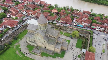 Mtskheta, Georgia - May 8, 2019:The Svetitskhoveli Cathedralis an Eastern Orthodox cathedral located in the historic town of Mtskheta, Georgia . Aerial view Stock Footage