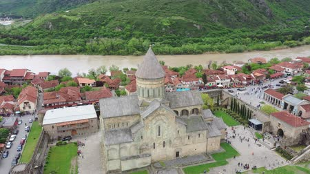 manastır : Mtskheta, Georgia - May 2, 2019: The Svetitskhoveli Cathedral is an Orthodox Christian cathedral located in the historic town of Mtskheta, Georgia. Aerial view