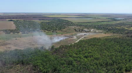 reciclado : Aerial view of a burning garbage dump.