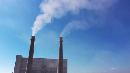 White smoke from the chimneys against the blue sky. Stock Footage