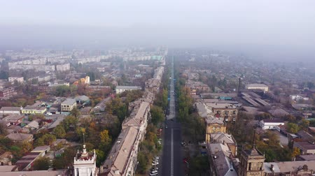 Mariupol, Ukraine - April 30, 2019: Aerial view of cityscape in smoke and fog. View from birds eye view to very dense morning fog over city.Problem of pollution of the environment by smoke and smog.