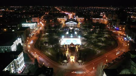 New Years illumination in a city park. You can see the rink. Aerial view