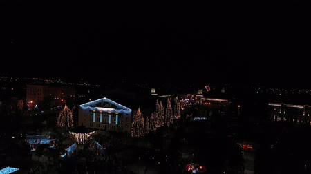 Christmas illumination in a city park. You can see the carousel. Aerial view