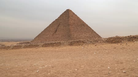 sarcophagus : Pyramid of Menkaure in Giza against the backdrop of an overcast sky. Egypt