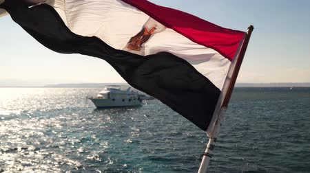 Egyptian flag on a background of a yacht in the open sea. Stock Footage