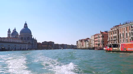 Venice, Italy - March 23, 2018: The Grand Canal is a channel in Venice, Italy. View from a floating boat. Slow motion