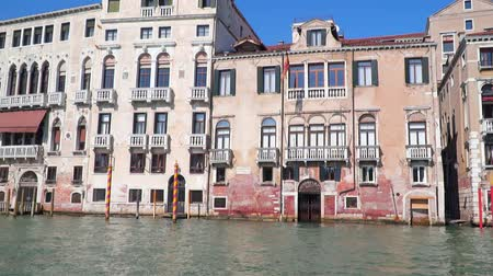 Venice Italy. Buildings near canals. View from a floating boat. Slow motion