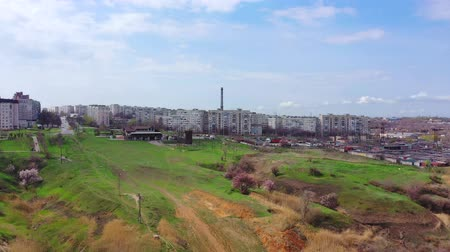 Mariupol Ukraine. Sleeping area of the city. You can see houses, streets, a large chimney. Aerial shooting. Spring