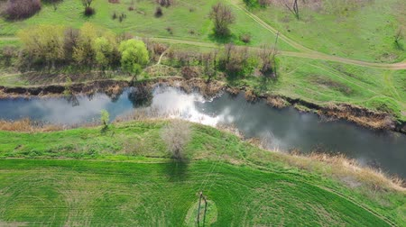Reflection of the sun and clouds in the river. Aerial view. Spring Stock Footage