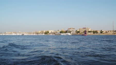 Luxor, Egypt - January 16, 2020: Nile river coastline in Luxor. Egypt View from a floating boat