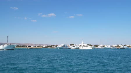 White yachts on the pier. The shore of the Red Sea in Egypt. View from a floating ship Vídeos