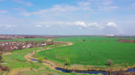 River and agricultural field in spring. Aerial view Stock Footage