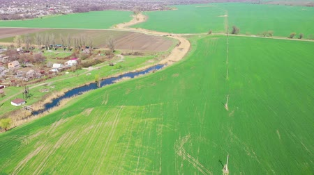 Agricultural field and river in the spring. Aerial view