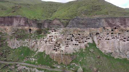 kazılmış : Vardzia, a giant cave city in Georgia. Aerial view. Stok Video