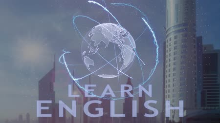 cite : Learn English text with 3d hologram of the planet Earth against the backdrop of the modern metropolis. Futuristic animation concept of global business