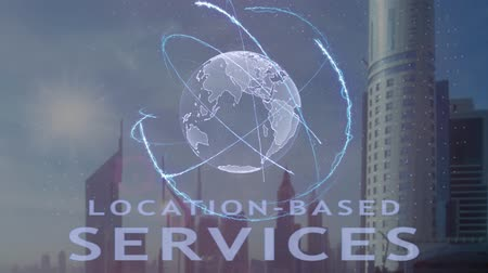 близость : Location-based services text with 3d hologram of the planet Earth against the backdrop of the modern metropolis. Futuristic animation concept