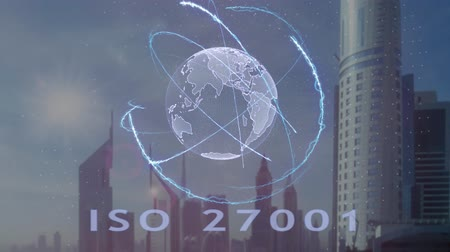 belgeleme : ISO 27001 text with 3d hologram of the planet Earth against the backdrop of the modern metropolis. Futuristic animation concept Stok Video