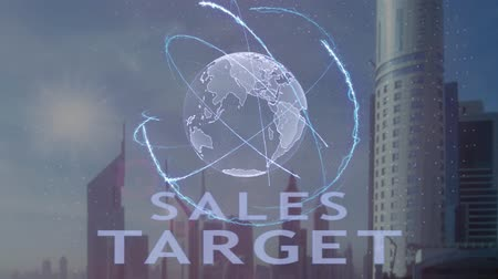 artış : Sales target text with 3d hologram of the planet Earth against the backdrop of the modern metropolis. Futuristic animation concept Stok Video