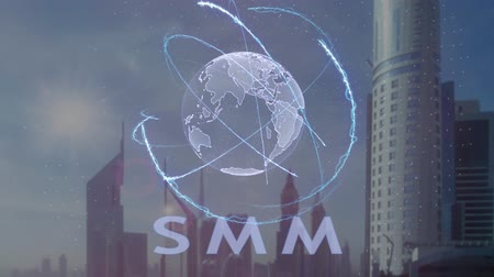 hodnost : SMM text with 3d hologram of the planet Earth against the backdrop of the modern metropolis. Futuristic animation concept Dostupné videozáznamy