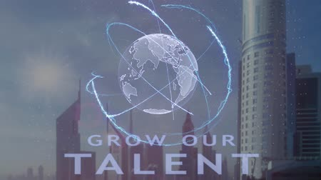 výhoda : Grow our talent text with 3d hologram of the planet Earth against the backdrop of the modern metropolis. Futuristic animation concept