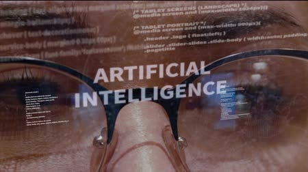 html : Artificial Intelligence text on the background of female software developer. Eyes of woman with glasses looking at programming network code space abstract technologies connecting global data network Stock Footage