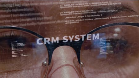 html : CRM system text on the background of female software developer. Eyes of woman with glasses are looking at programming network code space abstract technologies connecting global data network