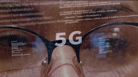 standardization : 5G text on the background of female software developer. Eyes of woman with glasses are looking at programming network code space abstract technologies connecting global data network