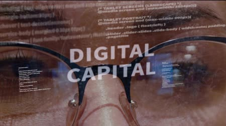 implemento : Digital capital text on the background of female software developer. Eyes of woman with glasses are looking at programming network code space abstract technologies connecting global data network Stock Footage