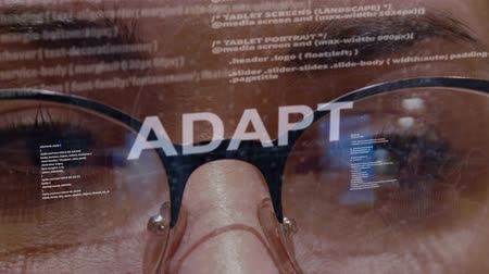 adapt : Adapt text on the background of female software developer. Eyes of woman with glasses are looking at programming network code space abstract technologies connecting global data network Stock Footage