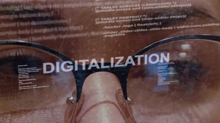 html : Digitalization text on the background of female software developer. Eyes of woman with glasses are looking at programming network code space abstract technologies connecting global data network