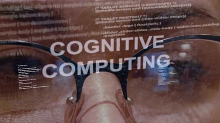 разведка : Cognitive computing text on the background of female software developer. Eyes of woman with glasses are looking at programming network code space abstract technologies connecting global data network Стоковые видеозаписи
