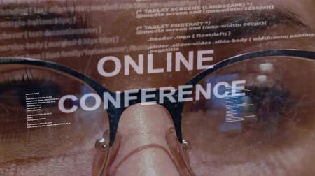 conferencing : Online conference text on the background of female software developer. Eyes of woman with glasses are looking at programming network code space abstract technologies connecting global data network Stock Footage