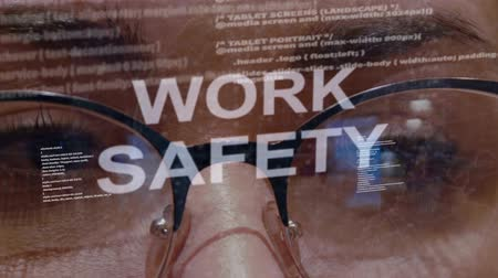 cuidadoso : Work safety text on the background of female software developer. Eyes of woman with glasses are looking at programming network code space abstract technologies connecting global data network