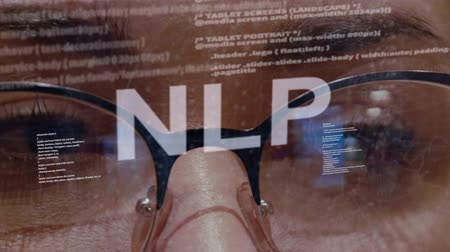 neuro : NLP text on the background of female software developer. Eyes of woman with glasses are looking at programming network code space abstract technologies connecting global data network Stock Footage