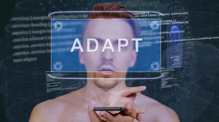 adapt : Young man interacts with a conceptual HUD hologram with text Adapt. Guy with future technology mobile screen on background of the program code