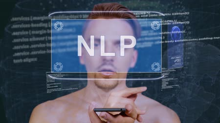 improve : Young man interacts with a conceptual HUD hologram with text NLP. Guy with future technology mobile screen on background of the program code