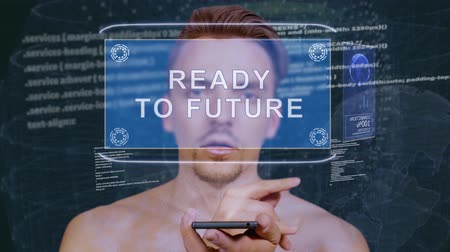 байт : Young man interacts with a conceptual HUD hologram with text Ready to future. Guy with future technology mobile screen on background of the program code