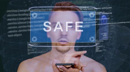 salvaguardar : Young man interacts with a conceptual HUD hologram with text Safe. Guy with future technology mobile screen on background of the program code