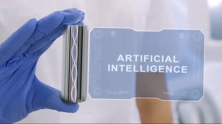 intelligencia : Hand in blue medical glove with a futuristic hud hologram with text Artificial Intelligence. Medical concept of the technology of the future. Doctor with Futuristic Holographic Gadget