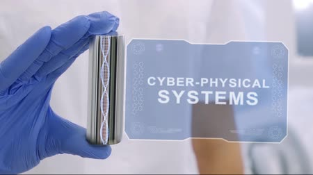 quantum computer : Hand in blue medical glove with a futuristic hud hologram with text Cyber-physical systems. Medical concept of the technology of the future. Doctor with Futuristic Holographic Gadget