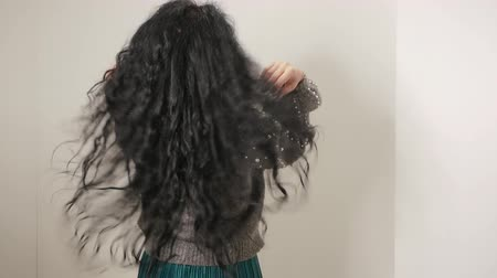 vlasy : Slow motion woman Shaking and touches hair. Curly brunette shows the condition of the hair. Hair Care