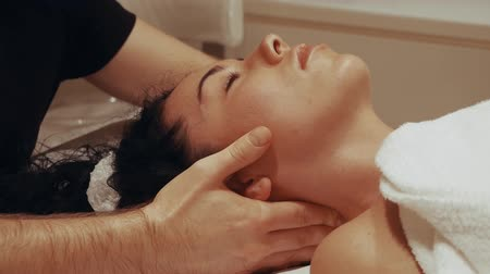 manipulacja : Professional massage of the cervical vertebrae. Chiropractor male hands massage the female neck. Beautiful woman on a massage table close-up
