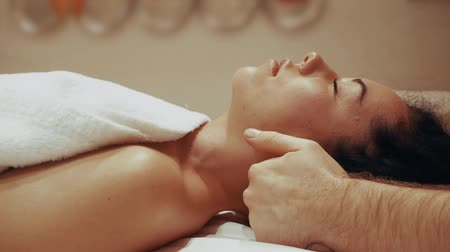 manipulace : Chiropractor male hands massage the female neck. Beautiful woman on a massage table close-up. Professional massage of the cervical vertebrae