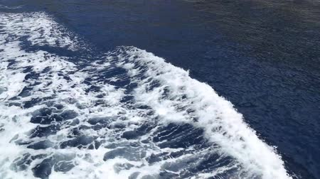 Boat makes ripples Stock Footage